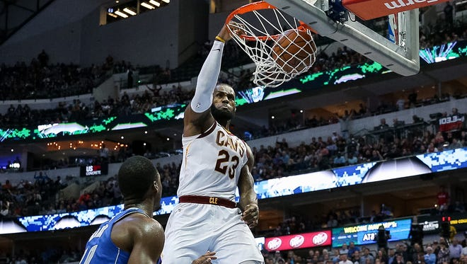 Cleveland Cavaliers forward LeBron James (23) goes to the basket for a slam dunk in the fourth quarter against the Dallas Mavericks at American Airlines Center.