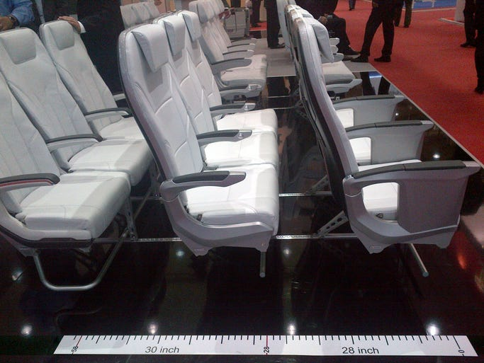 "ZIM hopes to win airlines over with their 28"" pitch seating layout. The center post for mounting the tray table helps preserve space, but putting a real person in the space doesn't leave much wiggle (or knee) room. No airline customers are currently announced."