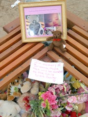 Baby Brianna Lopez's photo is displayed among stuffed