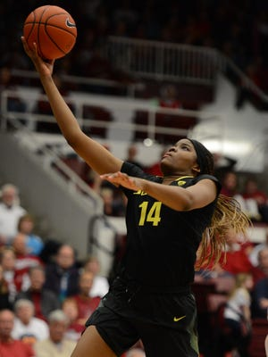 February 24, 2013; Stanford, CA, USA; Oregon Ducks forward Jillian Alleyne (14) drives to the basket against the Stanford Cardinal. Alleyne suffered a season-ending injury in practice this week.