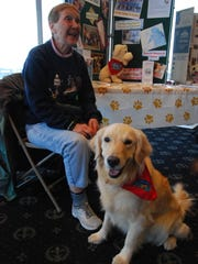 Sue Ostrom and Annie, a 3-year-old golden retriever, attended a fundraiser for the Fort Gratiot Dog Park.