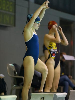 Reitz freshman Mikaela Jenkins prepares to compete in the 500 Yard Freestyle during a swim meet against the Mater Dei Wildcats at the Lloyd Pool in Evansville, Ind., Tuesday, Jan. 2, 2018. Jenkins had her left foot amputated when she less than a year old after being diagnosed with a rare birth defect called proximal femoral focal deficiency. She recently qualified for the U.S. Paralympic B Team in the butterfly event.