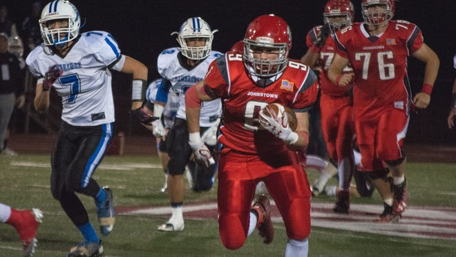Johnstown's Justin Franklin runs for a touchdown against Cambridge during a 2016 Division IV playoff game. The Johnnies will drop down to Division V in 2017.
