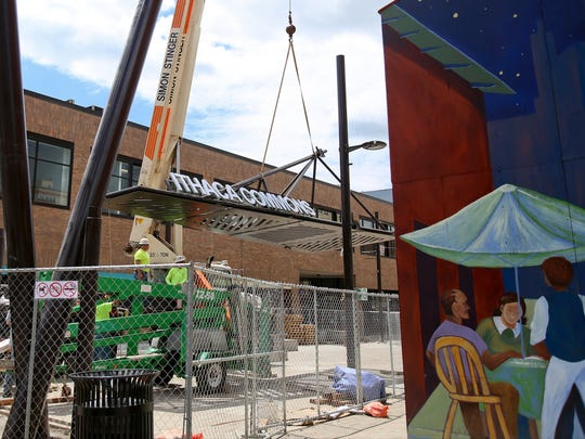 The sign for the Ithaca Commons is unloaded Thursday at the east end of the Commons.