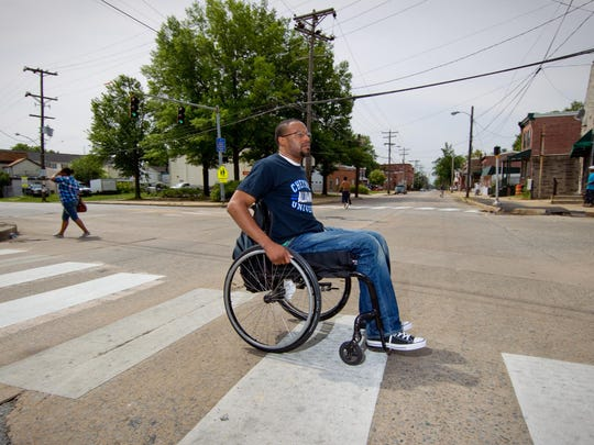 "Jonathan Wilson Jr., left paralyzed from the waist down when Rashie T. ""Smoke"" Harris shot him while robbing his barbershop, is shown in 2012, when he talked with The News Journal about his decision to testify at Harris's trial."