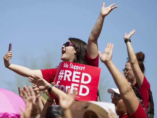 Mariana Tovar, an Arizona teacher, cheers during the RedforEd walkout at the state Capitol in Phoenix on May 3.