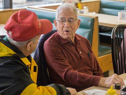 "Don ""Doc"" Wingard talks with Tony Ferrante as the meeting"