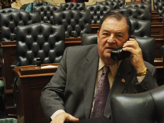 Delegate Norm Conway takes a call at his desk in the