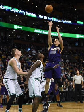 Phoenix Suns guard Devin Booker (1) shoots the ball