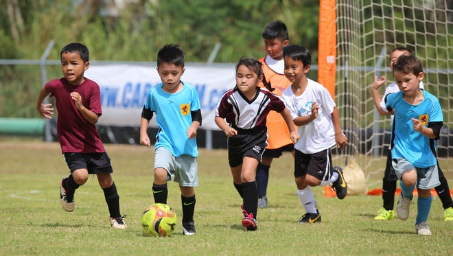 Sidekick SC and Tumon Typhoons Soccer Club play in a U8 division opening week match of the 2016 Triple J Auto Group Robbie Webber Youth Soccer League Spring season Saturday at the Guam Football Association National Training Center.