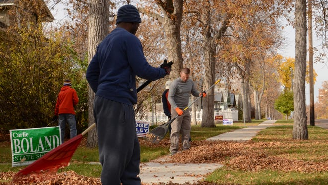 Airmen from Malmstrom Air Force Base clean the yard of an elderly person on 2nd Avenue North. Malmstrom partnered with the U.S. Postal Service and United Way of Cascade County to give back in the federal government's annual Day of Caring program.