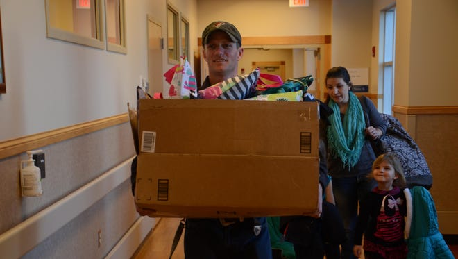 Alex Billmayer helps his wife, Jessi, carry 25 thermal tote bags filled with supplies to the NICU at Benefis Health System.