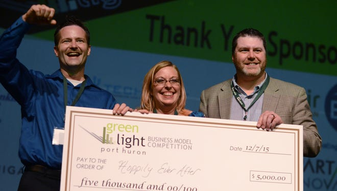 First place winners Scott and Shannon Schwabe accept their award for Hoppily Ever After, a wedding venue and hop farm Monday, Dec. 7, during the Greenlight Port Huron Business Model Competition at the SC4 Performing Arts Theatre.