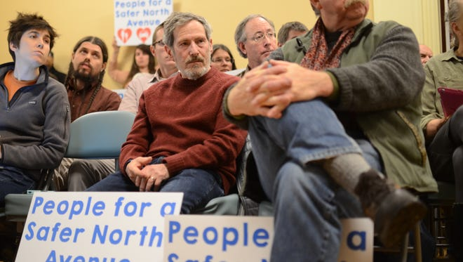 Proponents of the North Ave. Pilot Project show their support at the Burlington City Council meeting Monday evening.