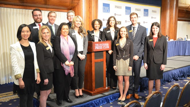 Members of the Purdue Institute for Civic Communication Student Polling Unit, with Executive Director, Ambassador Carolyn Curiel, gather at the National Press Club in Washington D.C. prior to announcing findings of their national poll on civic confidence; pictured with them are Bob Cusack, Managing Editor of The Hill, and Steve Scully, Political Editor at C-SPAN, the Cable-Satellite Public Affairs Network, partners of the event. Pictured L to R (front): Sunny Sun, Sutton Roach, Ambassador Carolyn Curiel (Executive Director), Liliana Pond, Nate Thomas, Mikaela Meyer; L to R (back row): Ben Baker, Steve Scully (Political Editor, C-SPAN), Bob Cusack (Managing Editor, The Hill), Riley Back, Jasmine Edison, Priya Malik