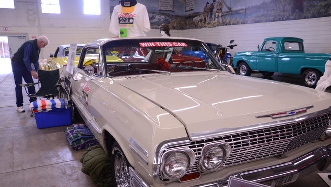 Mike Collins prepares his 1963 Chevy Impala for the Great Falls Custom Car Show at the Trades and Industries Building at the Montana ExpoPark.