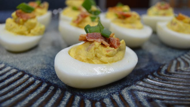 Deviled eggs are an easy treat to play around with, especially if you're a beginner cook. Try making this bacon cheddar deviled eggs perfect for parties.