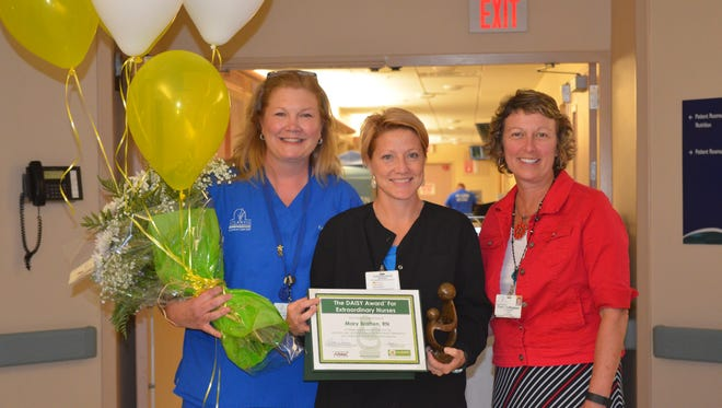 From left to right: Kelly Fox, RN, BSN; Mary Wilgus, RN, 4th quarter FY 2016 DAISY recipient; and Cheryl Nottingham, vice president of finance at Atlantic General Hospital.