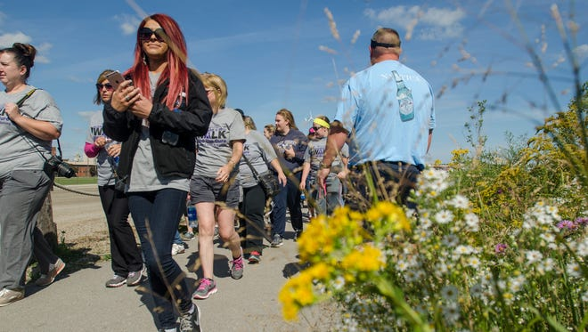 Participants start their walk Sunday, Sept. 25, during the Alzheimer's Walk along the River Walk in Port Huron.