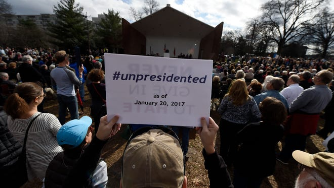 Hundreds gather in Centennial Park for the Silent Inauguration to protest the inauguration of President Donald Trump Friday Jan. 20, 2017, in Nashville, Tenn.
