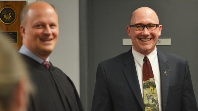 County Attorney Josh Racki, right, was appointed from deputy county attorney Wednesday by the Cascade County Commissioners by a 3-0 vote. Racki replaces Judge John Parker, left, who was appointed to district judge earlier this year.