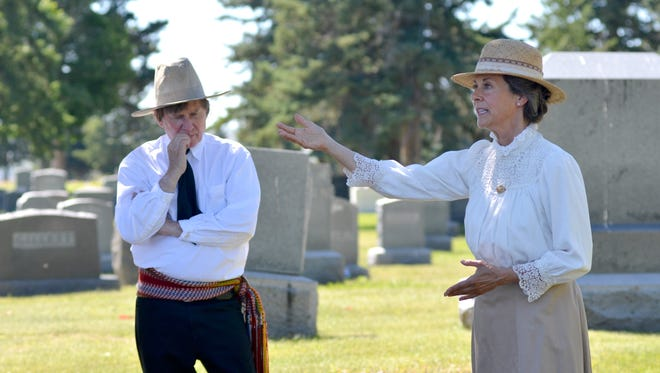 Great Falls City Commissioner Bill Bronson and actress Mary Jane Bradbury perform as Charles and Nancy Russell at the seventh annual Waking the Dead Tours on Sunday at Highland Cemetery.