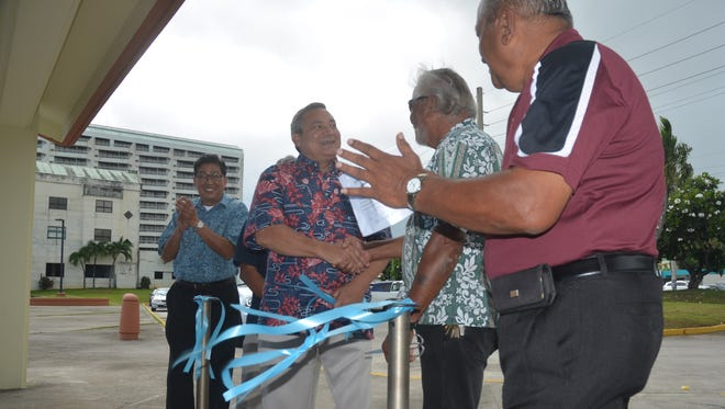 Gov. Eddie Calvo and other officials cut the ribbon for newly renovated pavilions at Alupang on July 26, 2017. The renovation and the LED lights installed in the area are part of four projects recently completed throughout the island to improve public pavilions.  The other pavilions are located in Umatac, Asan and Inarajan.