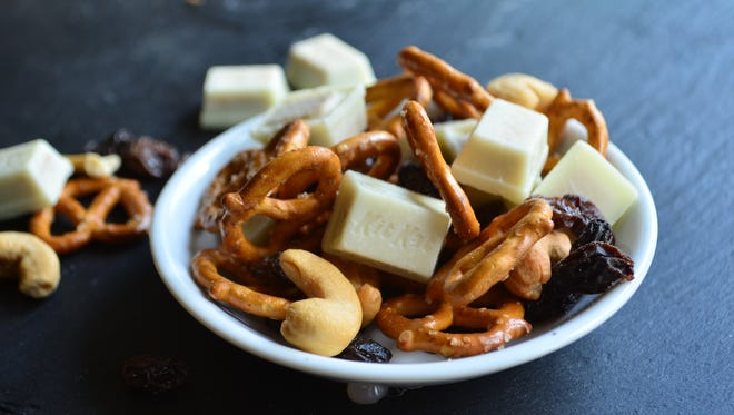 This trail mix is a perfect blend of sweet and salty, soft and crunchy. It combines crunchy pretzels, plump raisins, sweet white chocolate Kit Kats, and salty cashews. It's amazing.