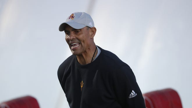 ASU's head coach Herm Edwards instructs defensive backs during a spring practice at Kajikawa practice fields on March 16, 2018 in Tempe, Ariz.