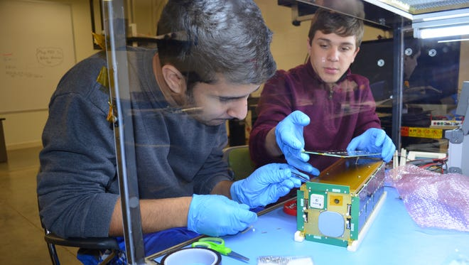 USI students designed, constructed and programmed the university's first spacecraft: University of Southern Indiana UNITE CubeSat.