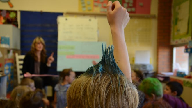 A student answers a question during TanDee Doran's lesson on writing opinions using linking words and compound sentences in her second-grade classroom at Sacajawea Elementary School.