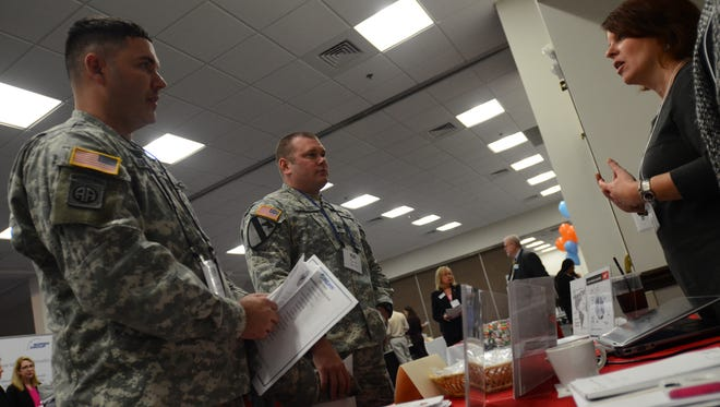 Patrick Sornsor, 38, of Marysville and Todd Sallee, 35, of Fort Gratiot, talk to potential employers at the St. Clair County Department of Veterans Affairs job fair on Wednesday at the DoubleTree by Hilton in Port Huron.