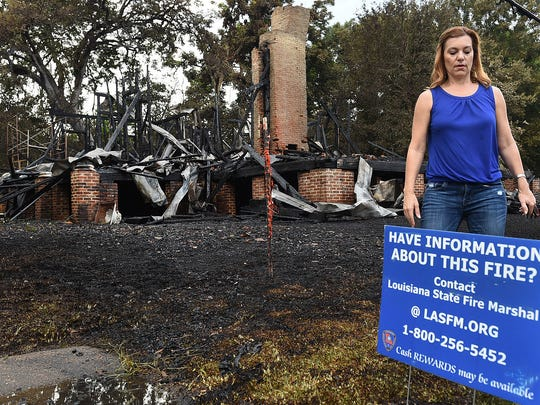 Melanie Lee Lebouef, city of Opelousas tourism director, surveys the remains of the Old Governor?s Mansion that was destroyed by fire July 14. The historic home had been under renovation.