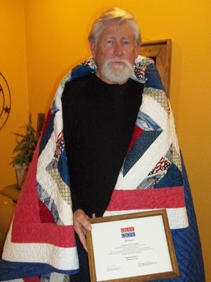 United States Marine Corps veteranJimmy Bradleywas recently awarded a Quilt of Valor by the Mountain Home Quilts of Valor at his home.Bradley served in Vietnam and Quantanamo Bay, Cuba, during his tours.