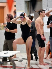 York Suburban's Cara Zortman adjusts her cap before swimming the 100-yard freestyle during a YAIAA swim meet Thursday, Jan. 19, 2017, at York Suburban. York Suburban swept Dover, with the girls winning 65-29 and the boys winning 64-30.