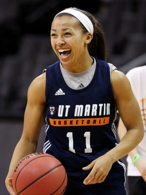 UTM's Heather Butler laughs during practice for an NCAA first round game.