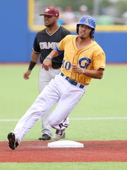Angelo State's Michael Urquidi rounds second base during