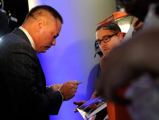 University of Tennessee head coach Butch Jones signs