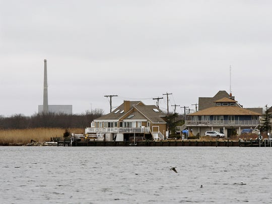 AP This 2010 photo shows homes along Barnegat Bay in Lacey with the Oyster Creek nuclear plant in the background.