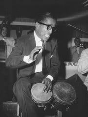 "Broadway performer Sammy Davis Jr., in ""Mr. Wonderful,"" plays the bongo drums at the Palladium Ballroom in New York City, May 27, 1956."