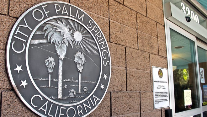 The Palm Springs city seal on a wall outside an entrance to City Hall.