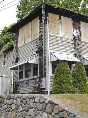 The scene of a weekend house fire at 20 Jane Road in the Wollaston neighborhood of Quincy on Sunday June 28,  2020 Greg Derr/The Patriot Ledger