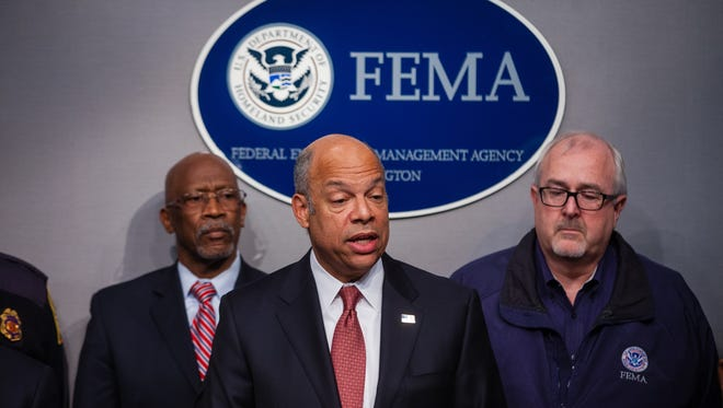 Homeland Security Secretary Jeh Johnson, center, speaks at FEMA headquarters in Washington, Thursday, Feb. 26, 2015, regarding a clean full-year appropriations bill for the Homeland Security Department.  Officials say that House Republicans are considering passage of a stand-alone, short-term funding measure to prevent a partial shutdown of the Department of Homeland Security at week's end. FEMA Administrator Craig Fugate is at right. (AP Photo/Zach Gibson)