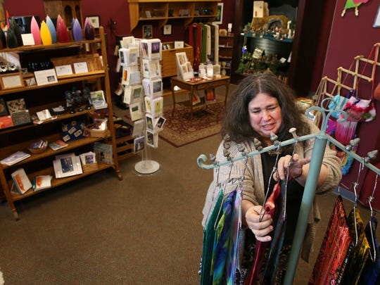 Shelly Carithers, owner of Creator's Hands, at work in her shop at 1311 Mt. Hope Ave. in College Town in Rochester Monday, May 23, 2016.