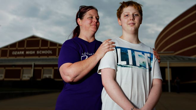 Ozark High School junior Lyle Howard, right, who came out as trans in eighth grade, poses for a portrait with his mother, Meghan Howard, outside Ozark High School in Ozark, Mo. on Feb. 28, 2017.
