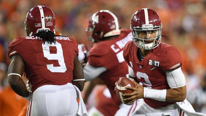 Alabama quarterback Jalen Hurts (2) looks to lead the Crimson Tide to a victory over Florida State in the 2017 Chick-fil-A Kickoff Game in Atlanta, Georgia.