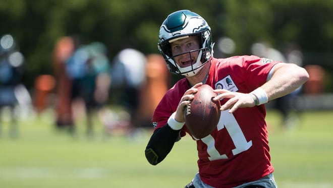 Philadelphia Eagles quarterback Carson Wentz (11) runs a drill during minicamp at Novacare Complex.