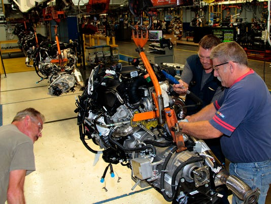 Mark Blake, Charles Vanatta and David Coutts inspect an EcoDiesel engine and.jpg