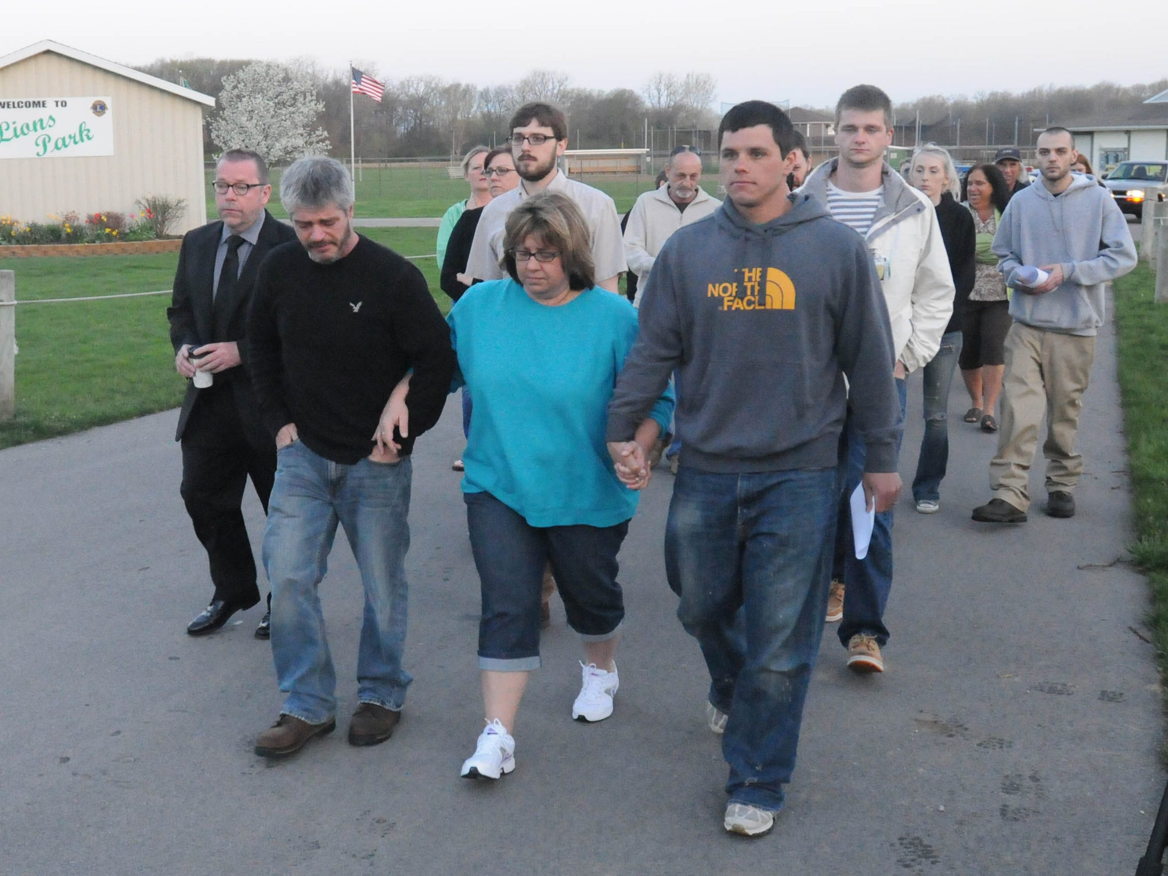 Family and friends of Jacob Limberios walk from Lions Park in Castalia to the site of Limberios' grave at the Castalia Cemetery in 2013.