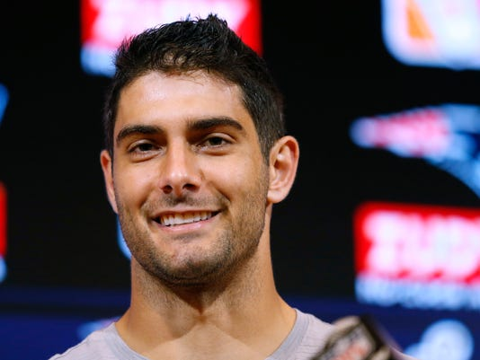 FILE - In this Thursday, Aug. 10, 2017 file photo, New England Patriots quarterback Jimmy Garoppolo speaks to the media following an NFL preseason football game against the Jacksonville Jaguars in Foxborough, Mass. On Monday, Oct. 30, 2017, the Patriots traded Garoppolo to the San Francisco 49ers for a 2018 draft pick. (AP Photo/Mary Schwalm, File)
